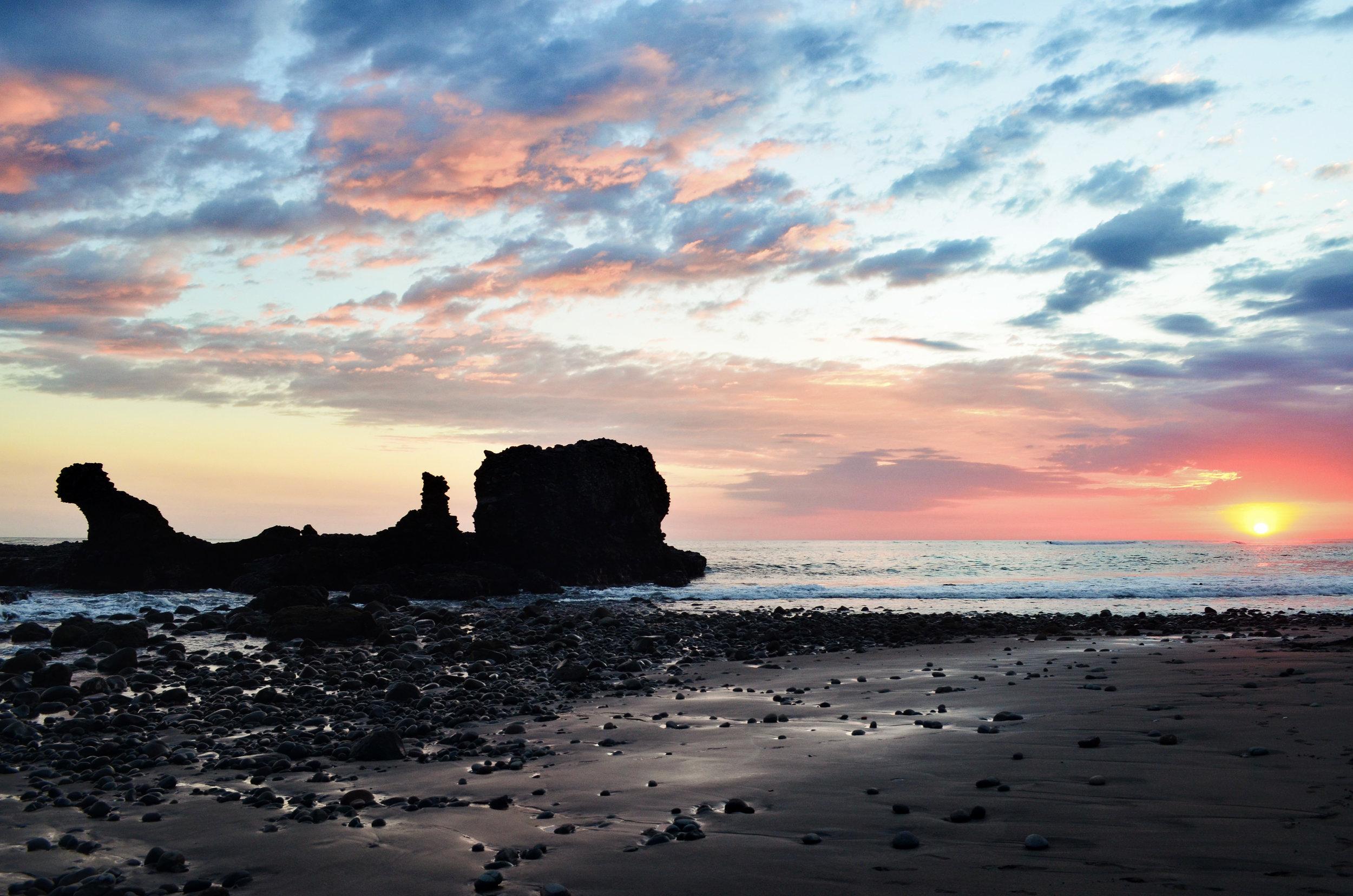 A beautiful sunset over the black sand beach at El Tunco, El Salvador