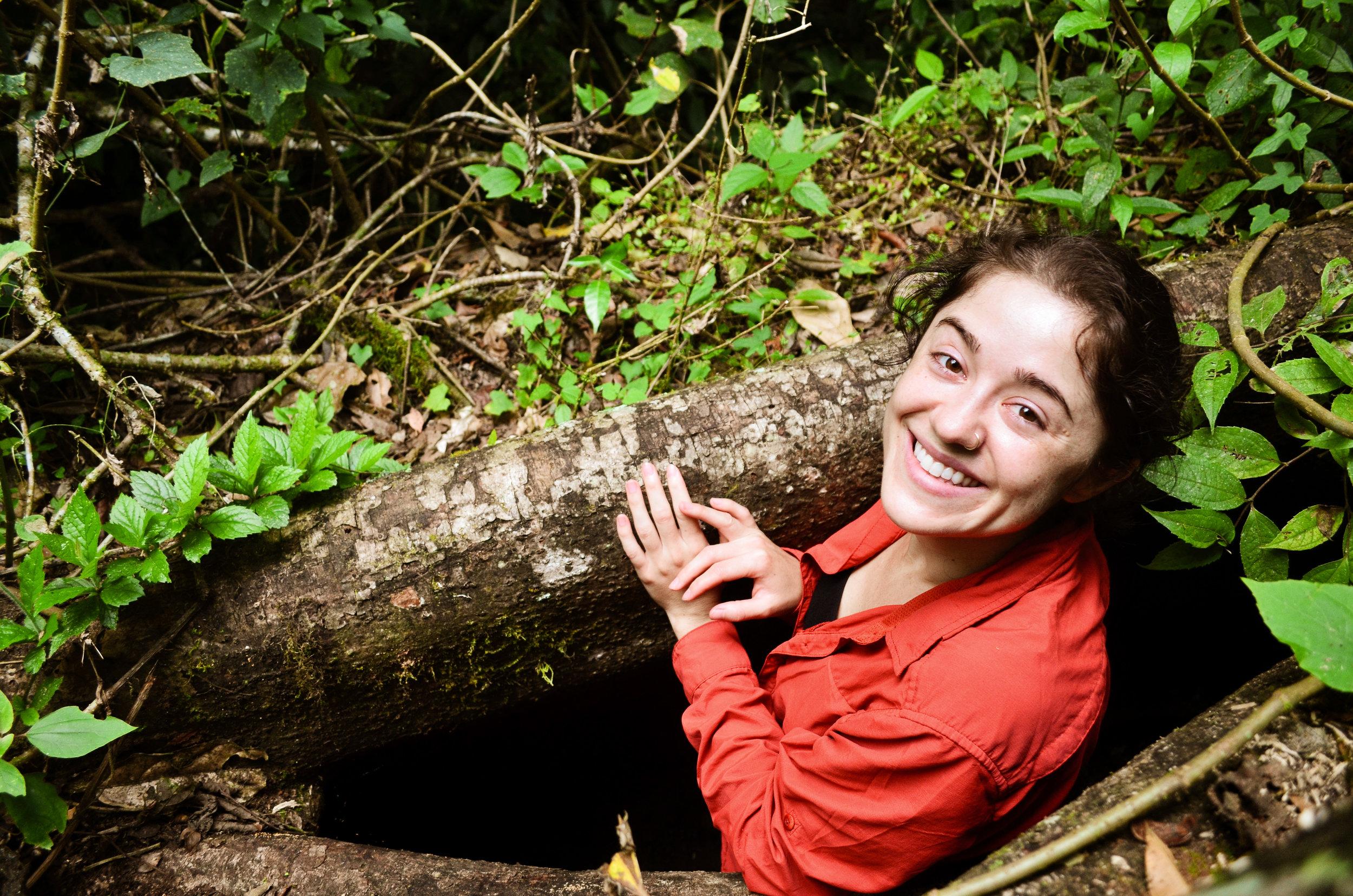 Rebecca peeking out from a matapalo tree