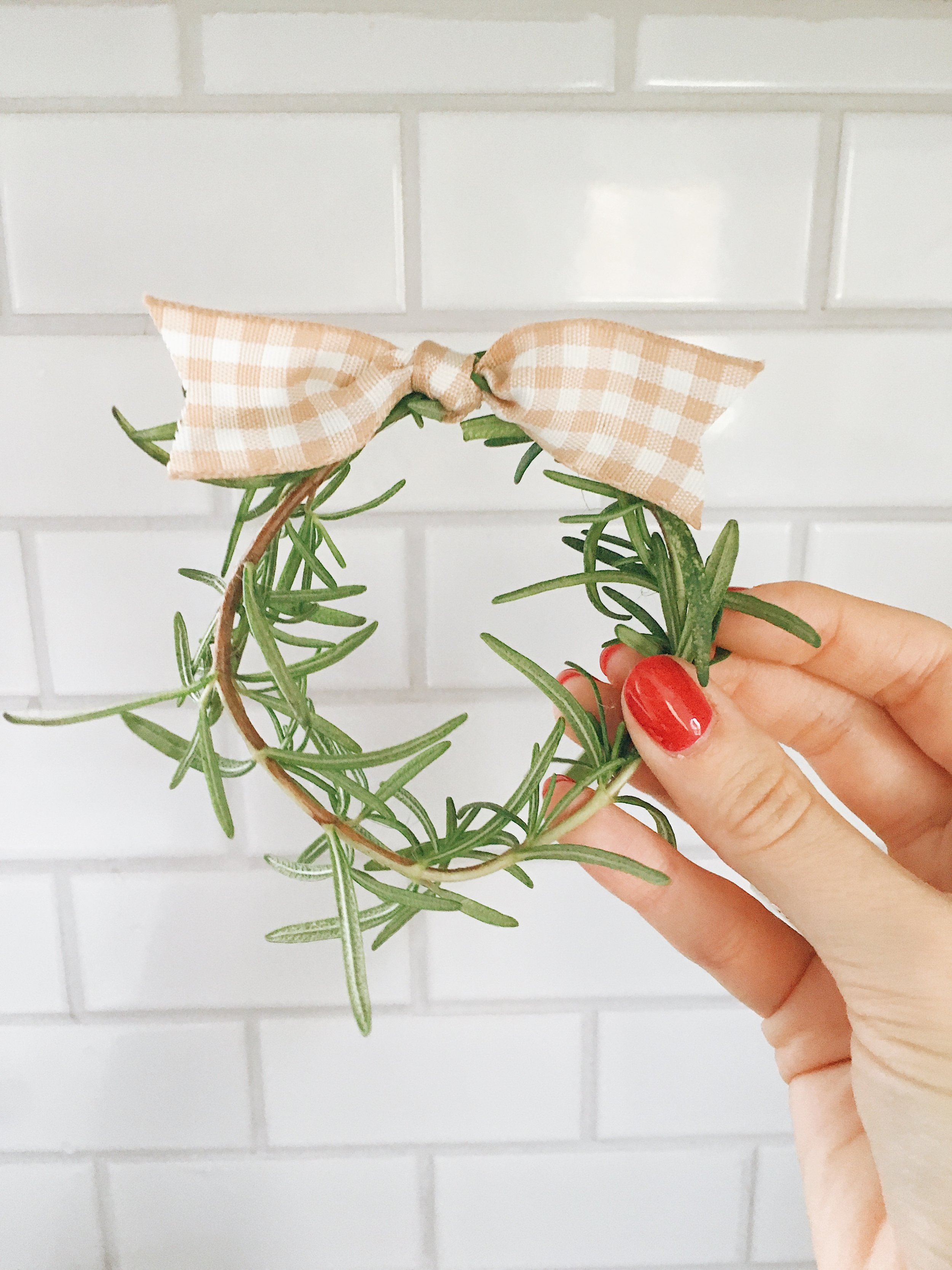 step: 3 - Use twine to tie together rosemary in a circular form. Tie ribbon in one knot over twine (to hide it). Cut edges to your liking.