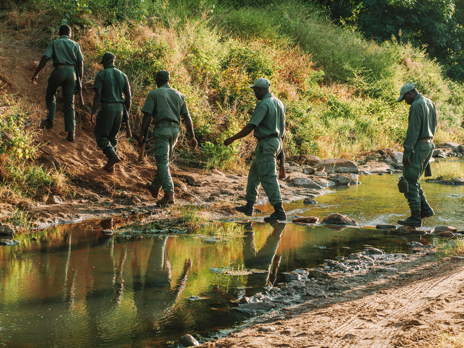 Park rangers crossing river.jpg
