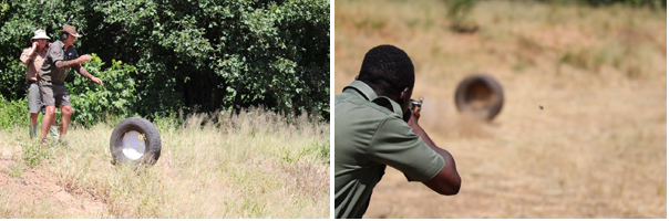 """A ZimParks ranger on the Advanced Weapons Course hones his """"moving target"""" skills by shooting at a target imbedded into a rolling vehicle tyre set in motion by course tutors John and Andy."""
