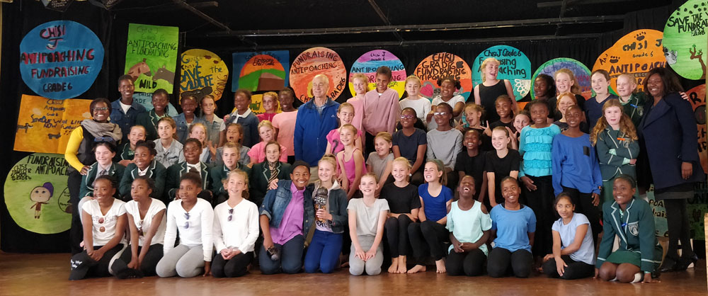 Zambezi Society Strategic Director, Richard Maasdorp (centre left in blue) and the Grade 6 classes of Chisipite Junior School Harare, and their teachers, who raised money for anti-poaching in 2019.