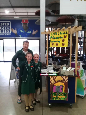 Zambezi Society Operations Manager, Peter Musto, with two of the Chisipite Junior School fund-raisers, working hard to attract funds in a local hardware store in Harare!