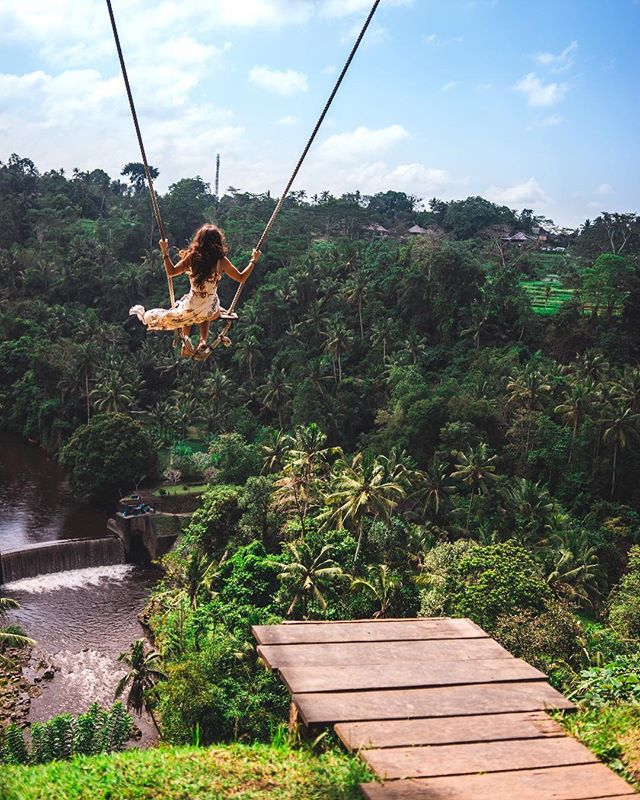 Personal swing hideaway in Bali, this property overlooks terraces and a waterfall. @maria.treen wrote a travel guide about her favorite spots to see in Bali, and how to absorb and connect to this beautiful culture. Read about it on the blog! bit.ly/BestOfBaliTravel (link in bio!)