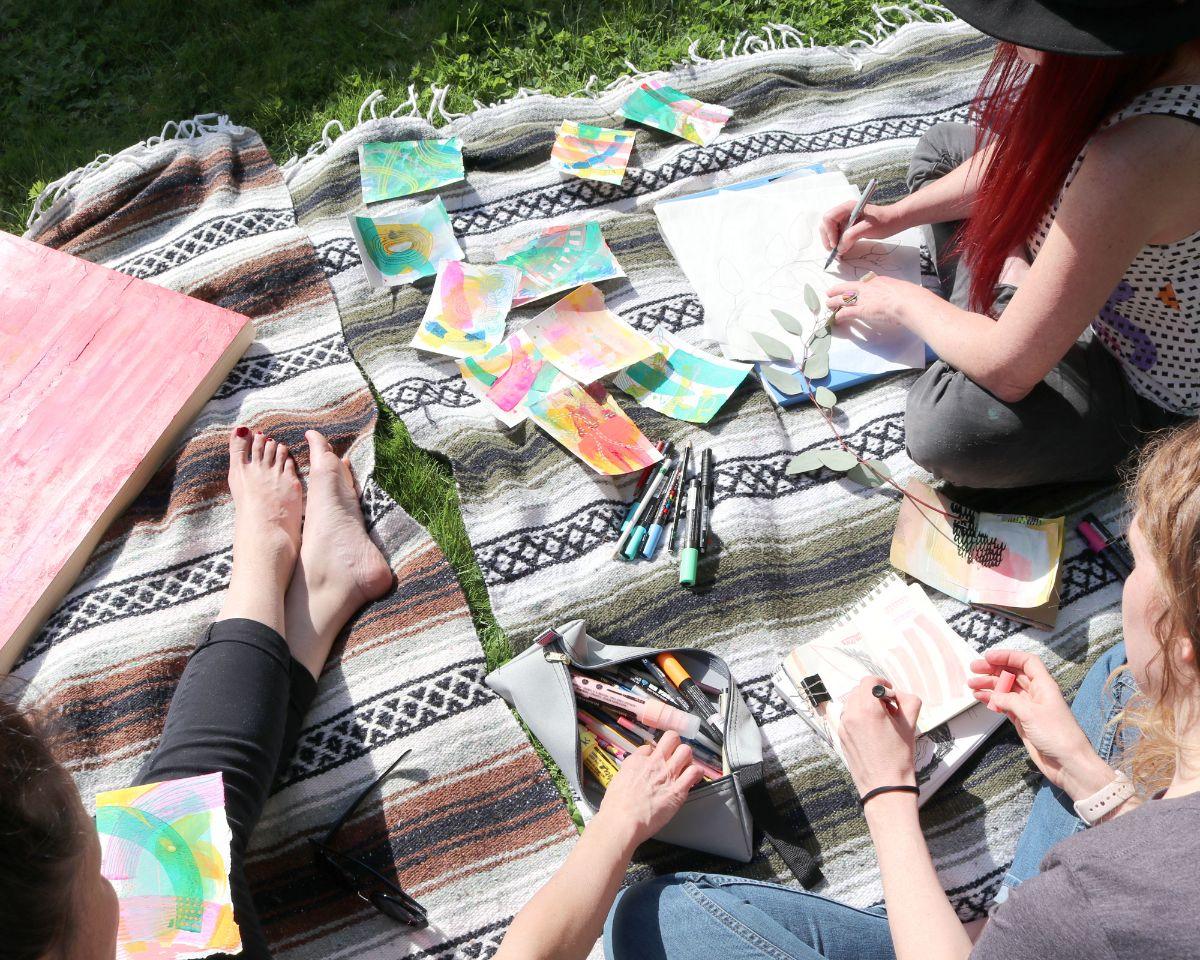 AnnamiekaHoppsDavidson-Art-Retreat-Working-outside-on-a-blanket.jpg