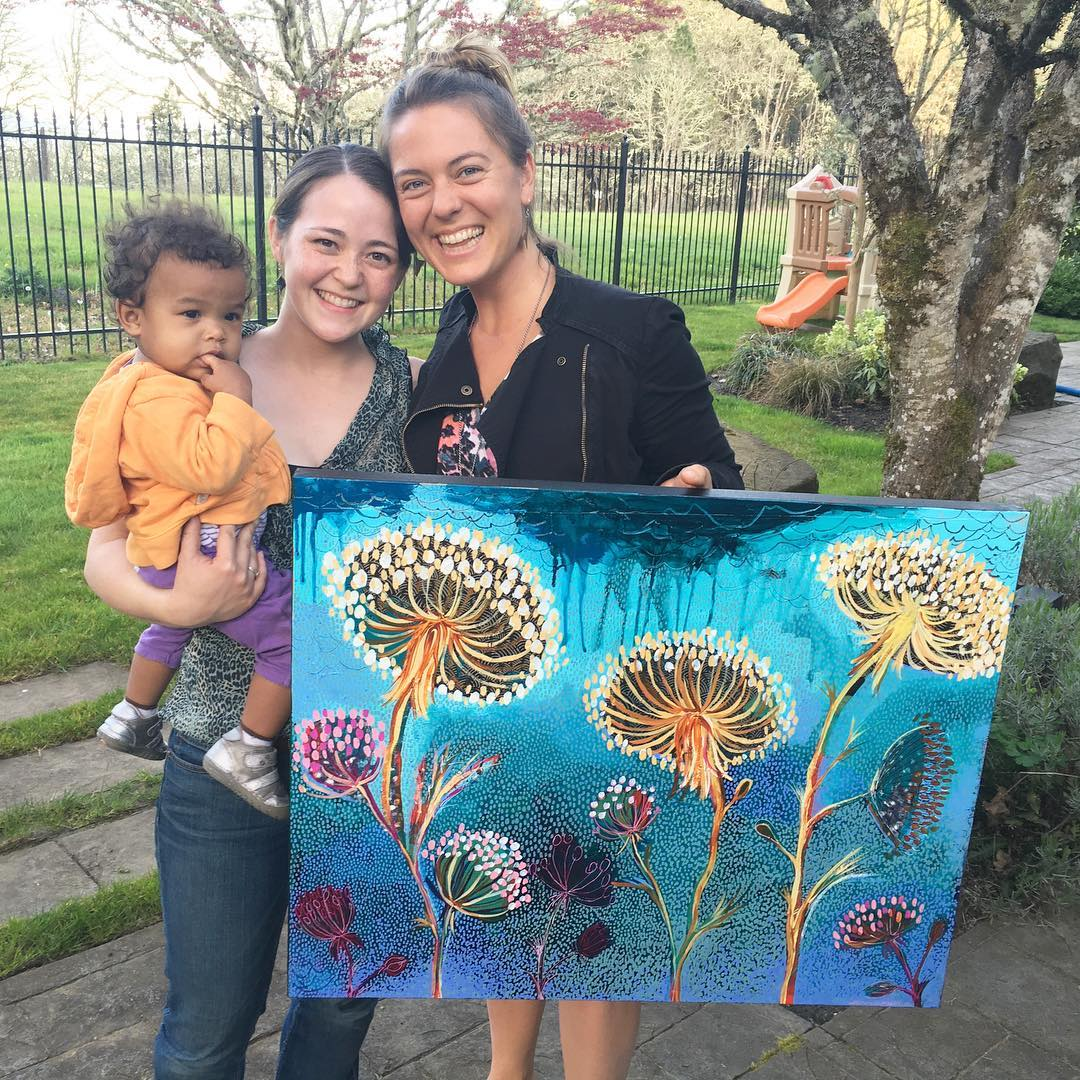 Photo of Annamieka delivering painting to Jessica to go with testimonial.jpg