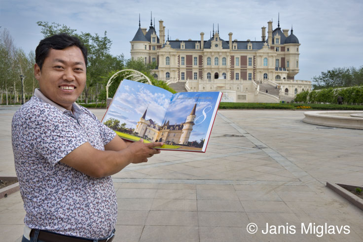 - Way out in China's western desert of Xinjinag province, the General Manager of Changyu Chateau Baron Balboa holds up a copy of my third table-top wine book, China the New Wine Frontier. While the book won awards like Best in the World, it is only available in China.