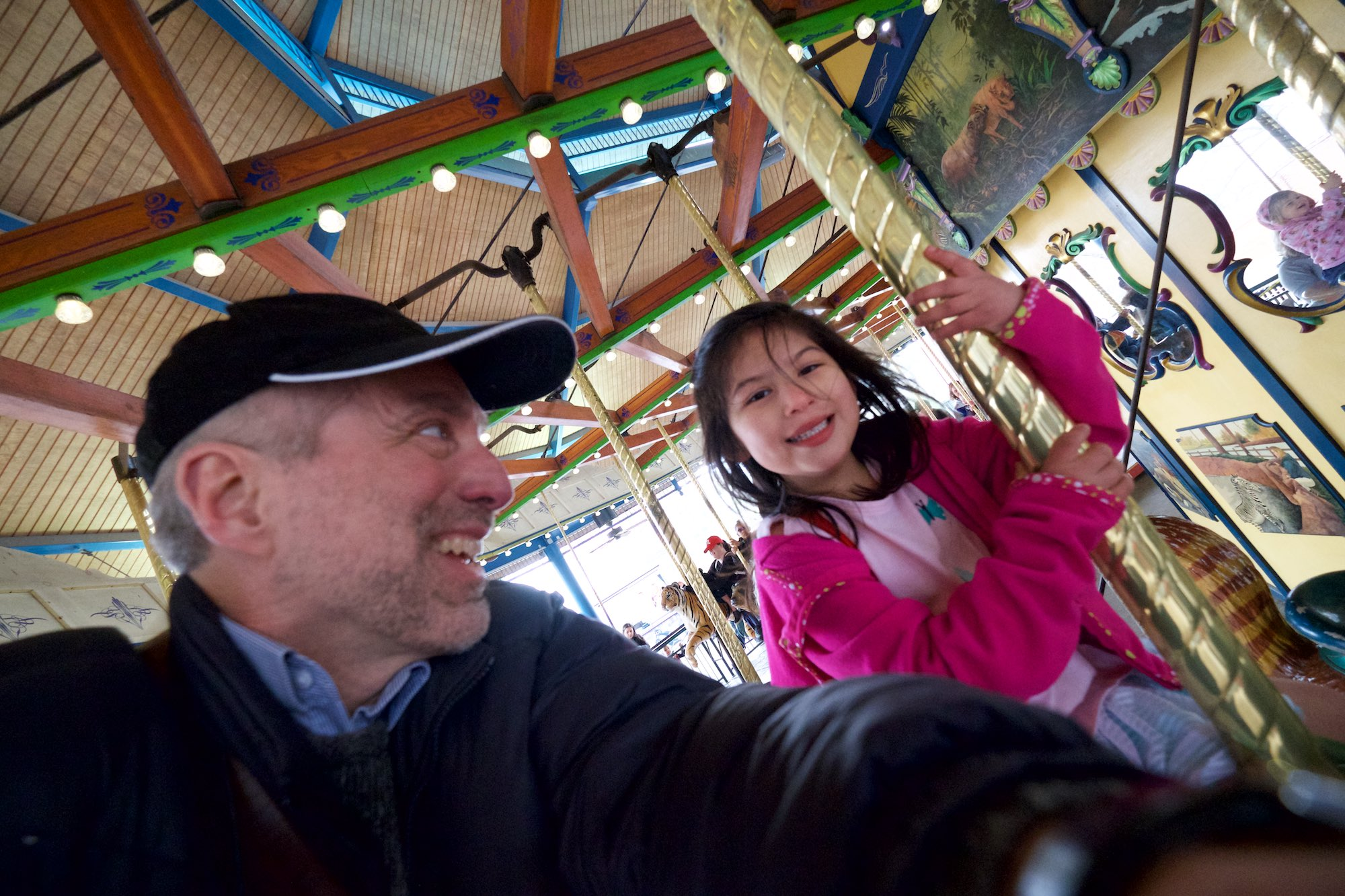 Day 78 - Some old guy and his granddaughter ride the carousel in the zoo.
