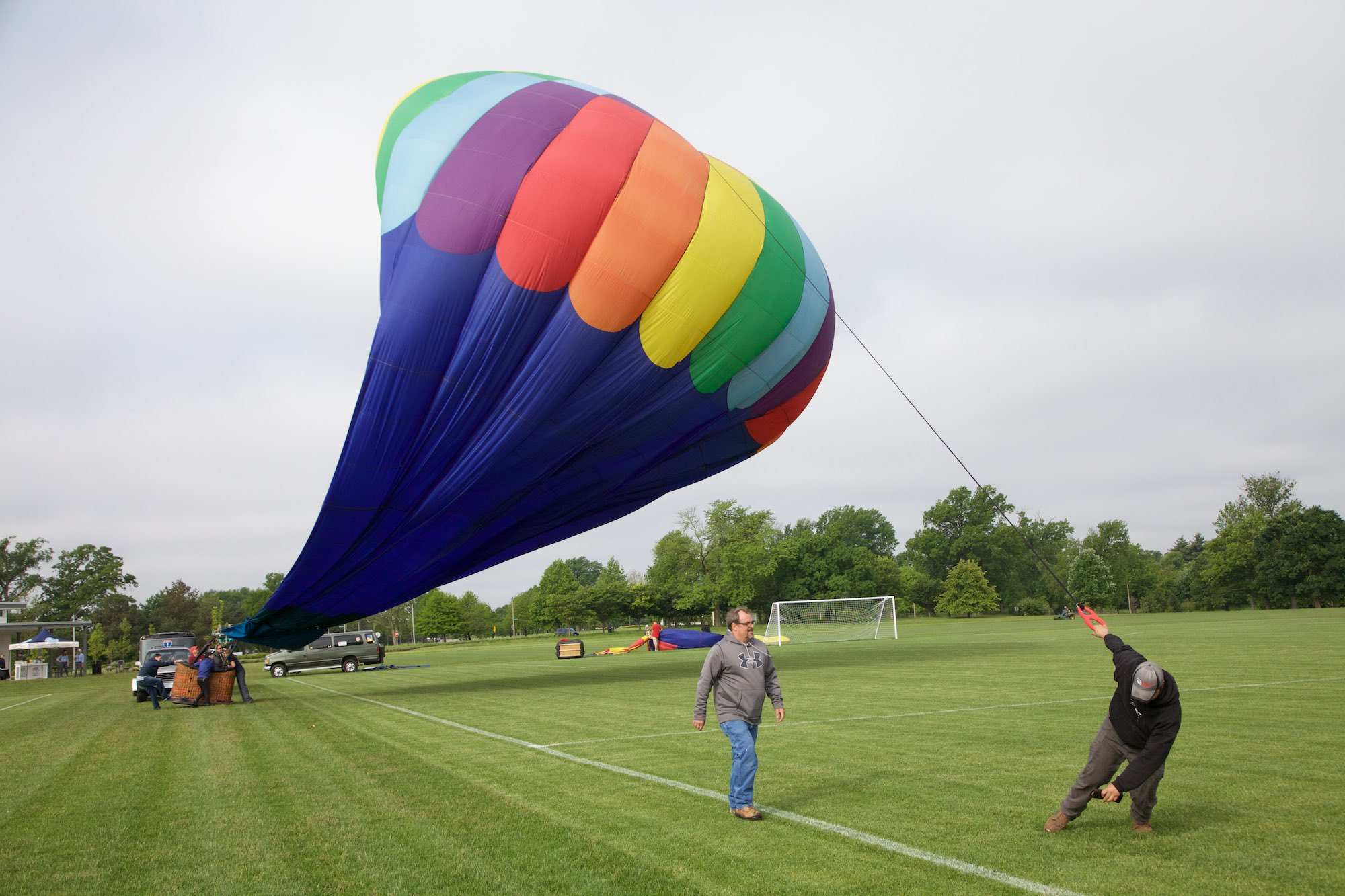 The crew of the balloon Jambo say goodby at the end of a test flight. Click on this image for more photos.