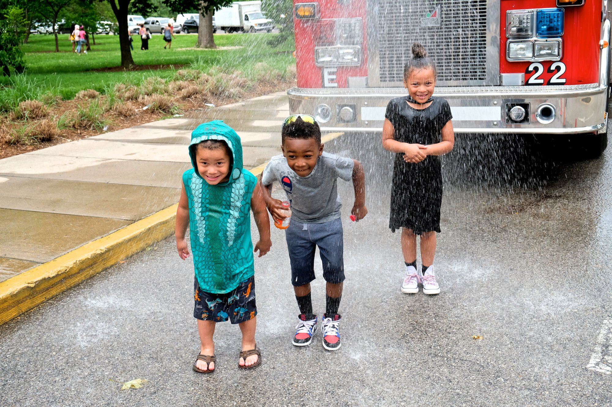 A water sprinkler on a hot day is the coolest thing ever! Click on the photo to see even more!