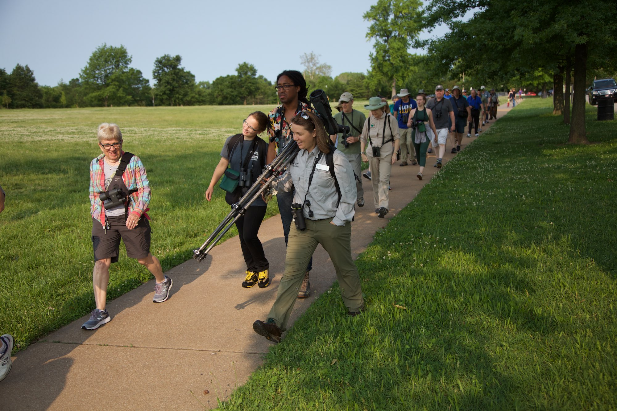 Amy Witt, the Forest Park Forever park ecologist, leads a procession of homo sapiens on a journey of avian discovery. Click on the image for more photos.
