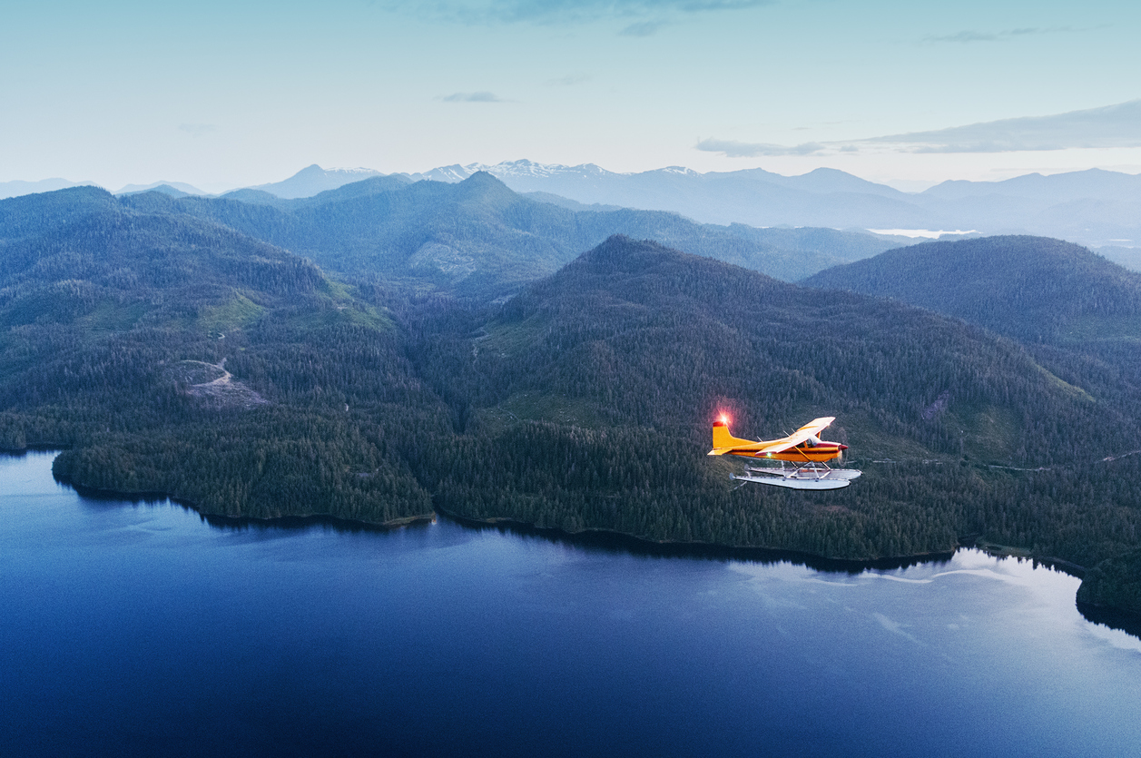 A float plane flies high above Alaska