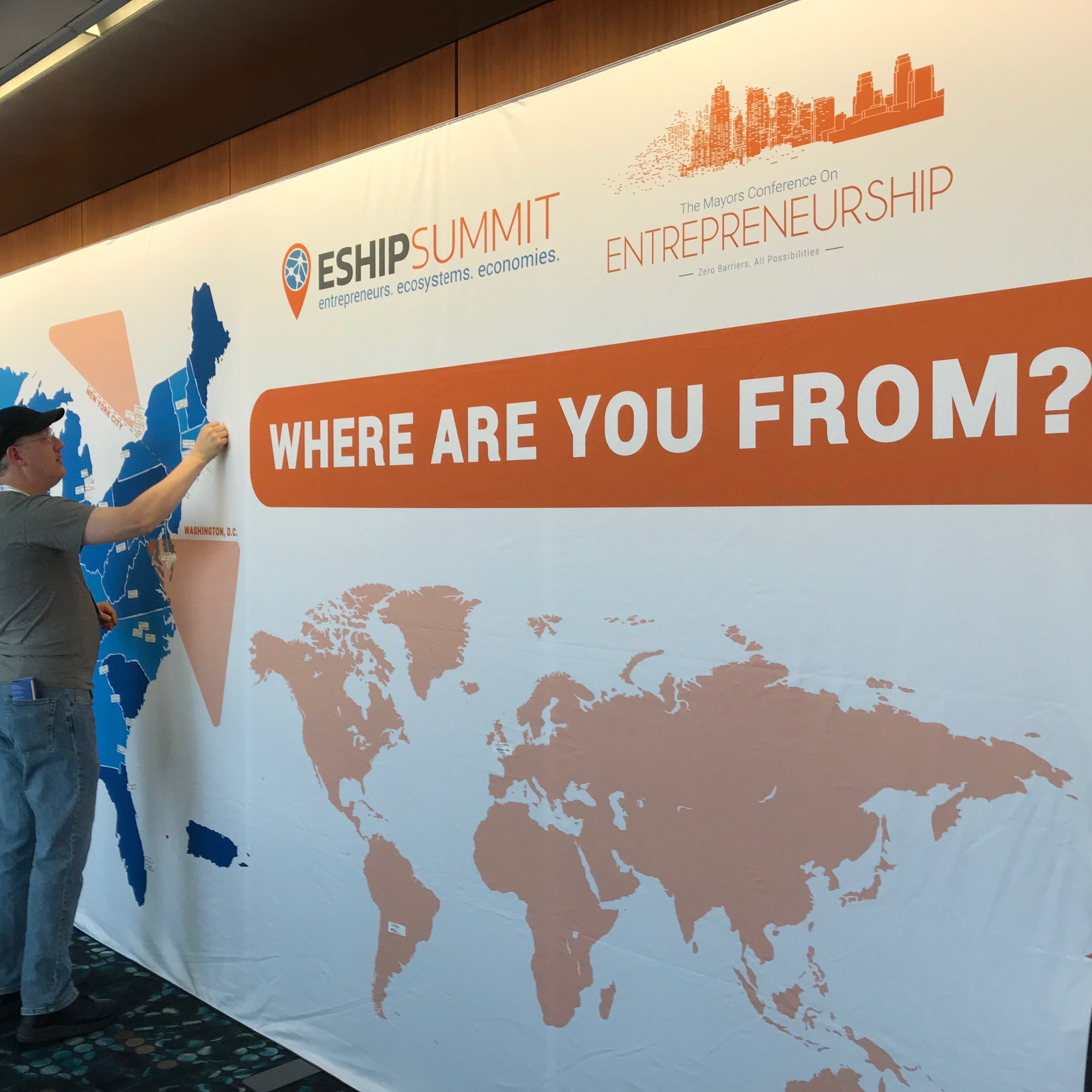 An attendee of the ESHIP conference adds his hometown to a map of the world.