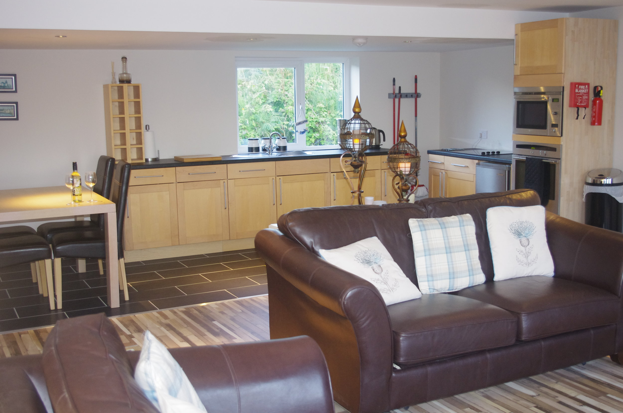 Sitting, Kitchen and Dining Area - Front to Rear - Photograph 1.JPG