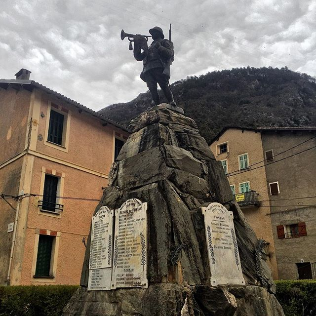 The #Memorial to the fallen of #WWI and #WWII in the small southern #Alpine town of #Fontan in #France where bunkers are scattered among rocky peaks. The bronze #soldier plays a trumpet atop a rock symbolic of the #French #Alps where fighting took place. As one can see from the last names, presumably many of the men came from the same families. #monument #battle #travelphotography #sculpture #worldwar1 #warmemorial #warmemorials #inmemoriam