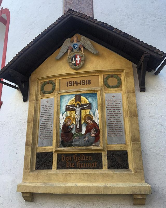 On the side of a #church in the sleepy #Austrian town of Mautendorf is a #warmemorial to the fallen of #WorldWarOne. These men served in the army of the #AustroHungarian Empire. Bronze reliefs of a #stalhelm and bayonet sit below the honor rolls. Note the repeated surnames, likely indicating that families lost several relatives in the war. #greatwar #military #travelphotography #architecture #wwi #austria #alps #austrianalps #warmemorials #wwicentenary #krieg #history #1914  #1918