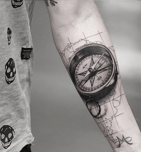 Realistic  A realistic portrait of your favorite rockstar or a compass. Many photo-realistic tattoos are done in black and grey.    Recommended artist: Mitch