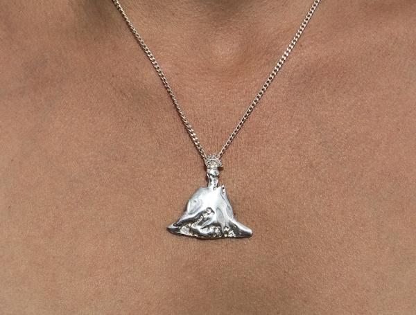 Parangaricutirimicuaro , 2018 | Series of cast silver pendants (Virgin San Juan de los Lagos as volcano).