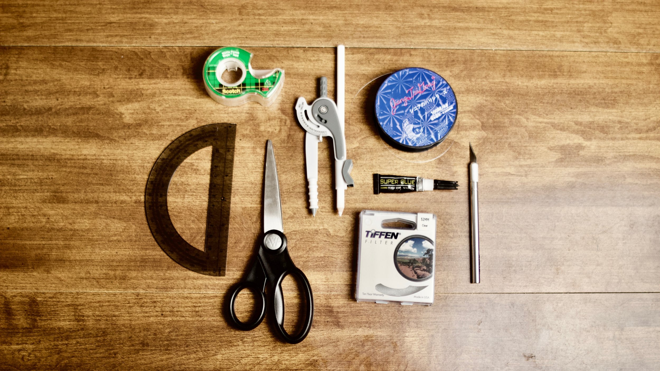 scissors-compass-protractor-tape-tiffen-lens-filter-fishing-line-superglue-xacto-naples-florida-swfl-filmmaking-film-diy