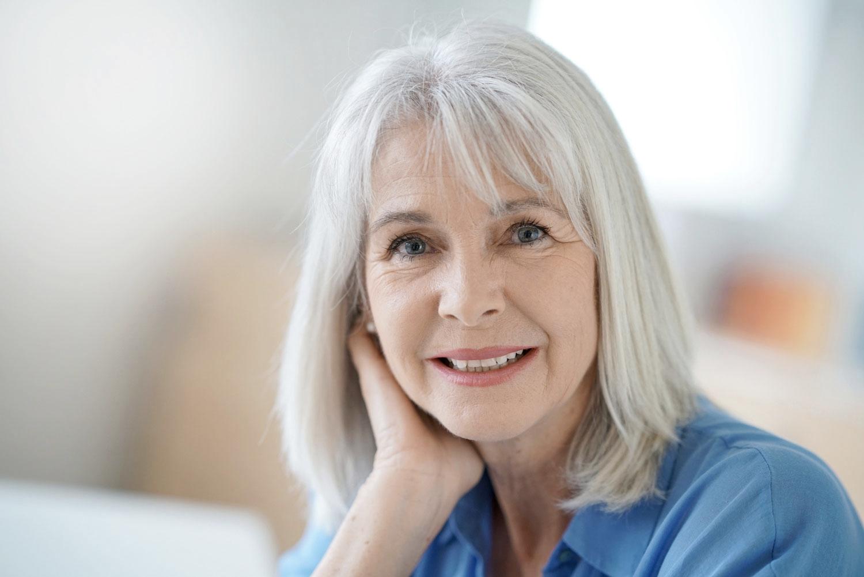 Senior lady smiling after smile makeover service