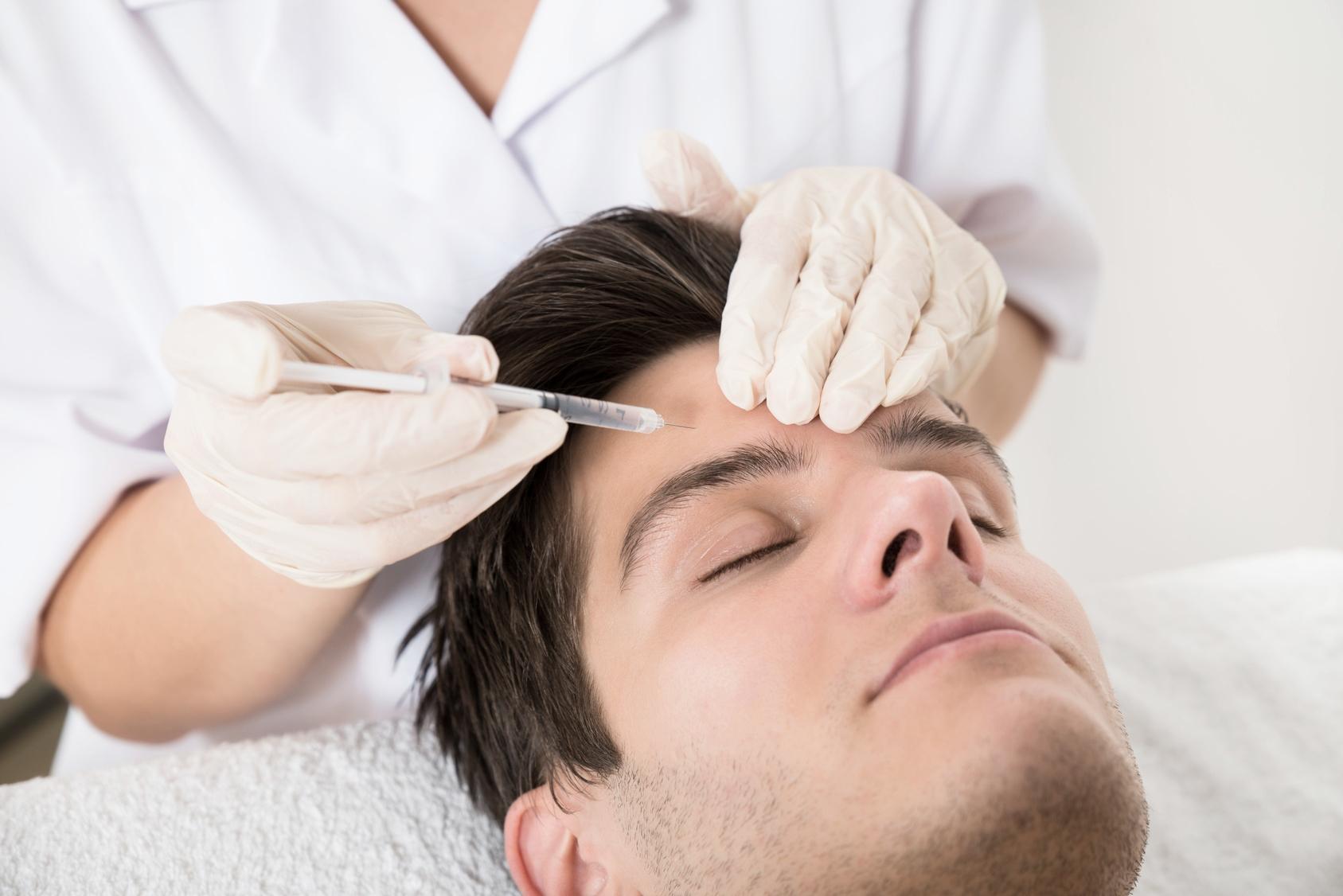 Man having Botox injections at the dentist