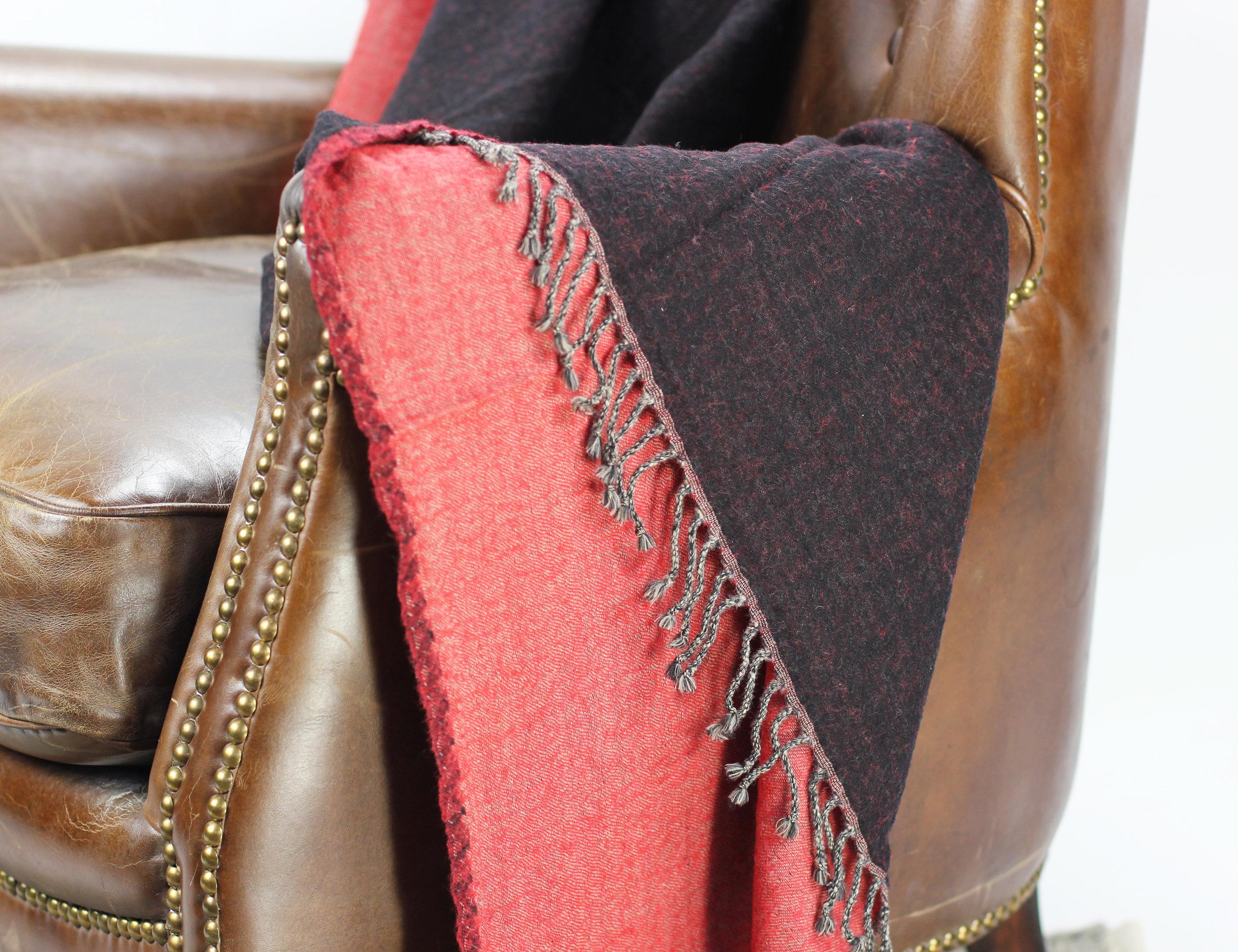 Merino Wool Rev Throw_Black.Red Chair Detail.jpg