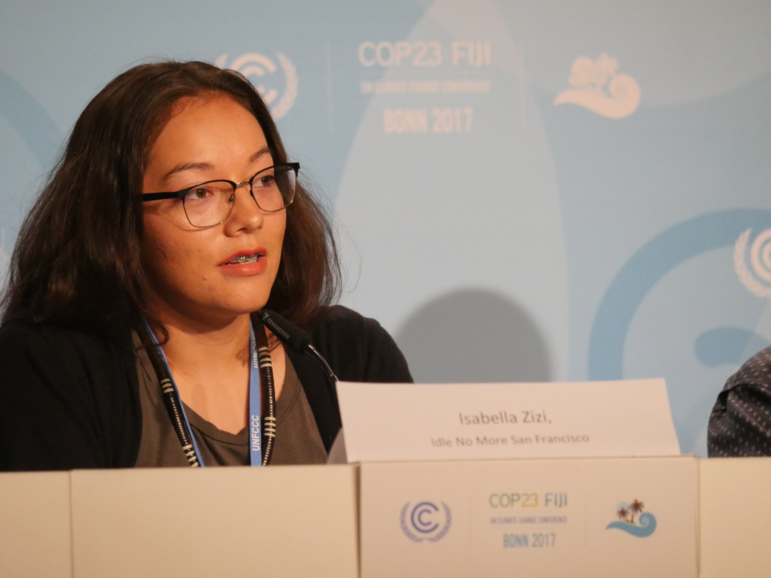 Isabella Zizi of Idle No More SF Bay Area, speaking at COP23 about false solutions such as carbon trading. Photo Courtesy: Jade Begay, Indigenous Rising Media.