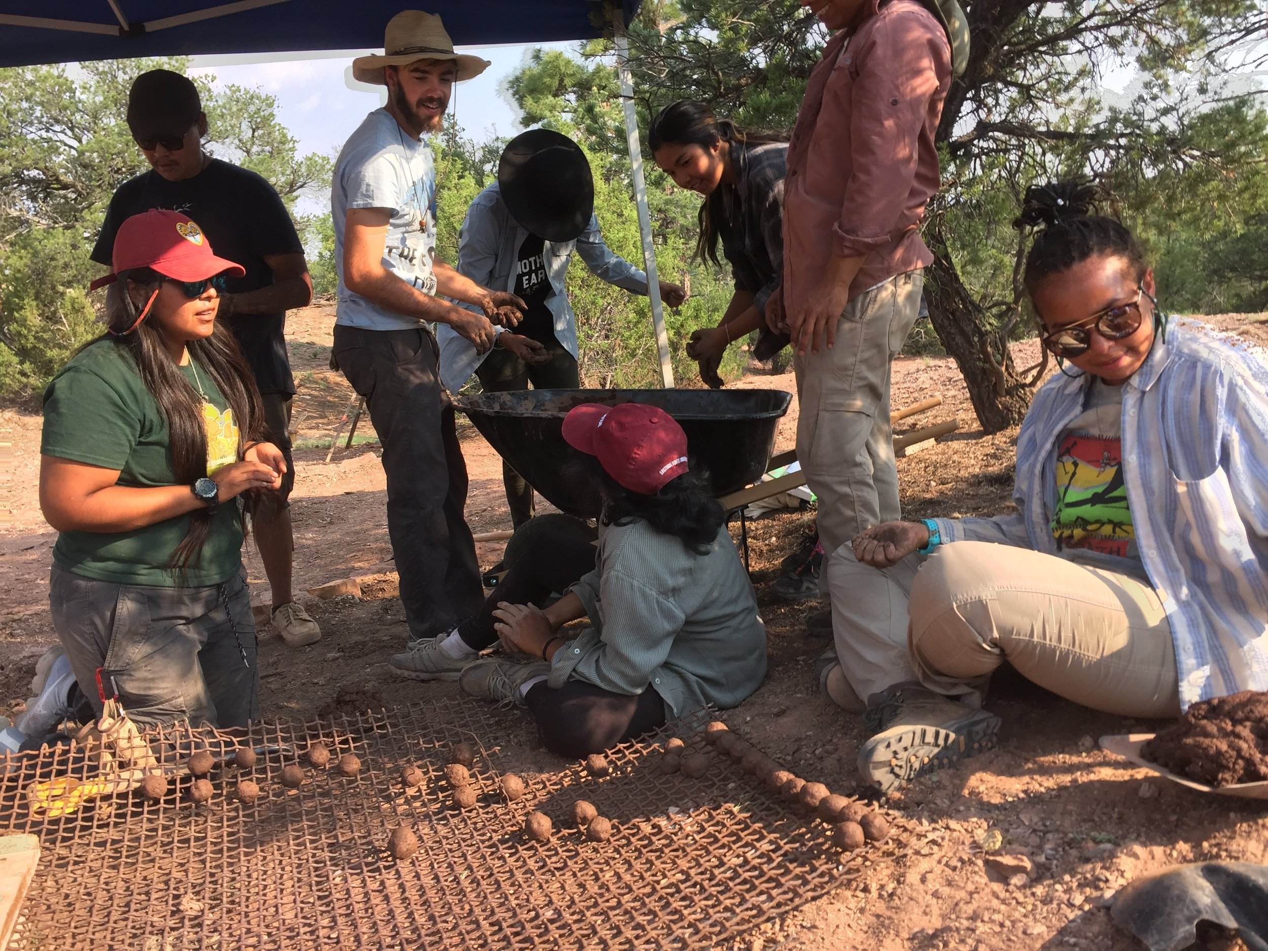 Doris Duke Scholars came thru with the medicine and helped us make hundreds of seed balls. They also helped make contour dams.