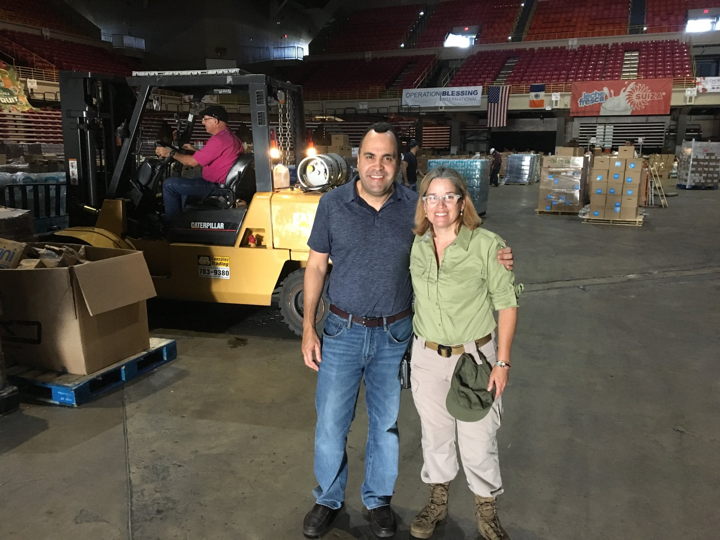 Hispanic Federation President, Jose Calderon and San Juan Mayor, Carmen Yulin. Hispanic Federation delivered 220,000 pounds of water, food and other essentials to the Roberto Clemente Coliseum in San Juan