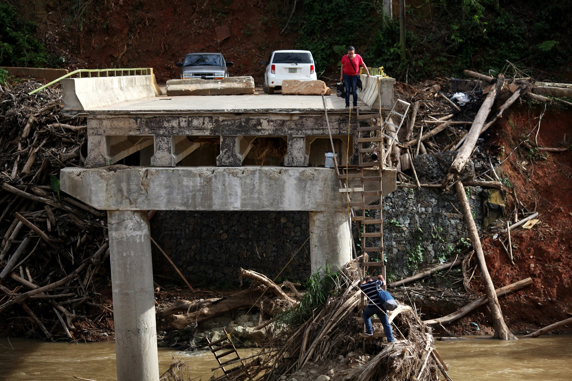 171120-puerto-rico-hurricane-maria-bridge-collapsed-sg-1321_407f5e3fe10f9e9c889c66fdc3a2c819.fit-2000w.jpg