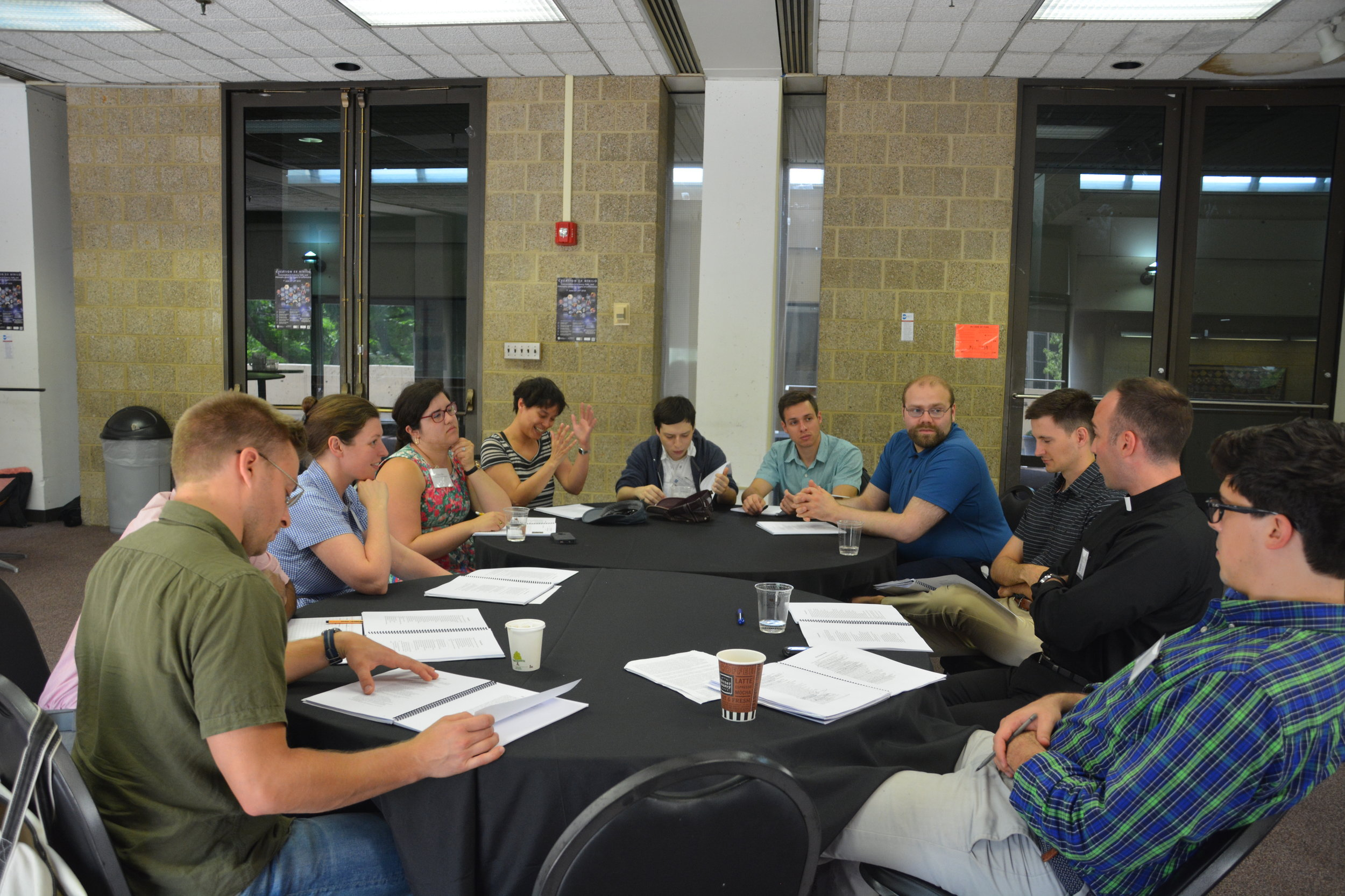 Resident scholars engaging in roundtable discussions at Magi's 2018 summer seminar