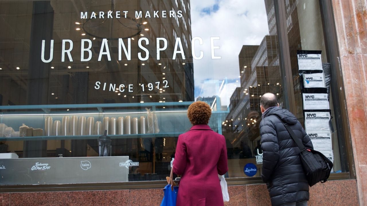 Passerby's peek in the window of the newest Urbanspace location at 570 Lex. AMNY