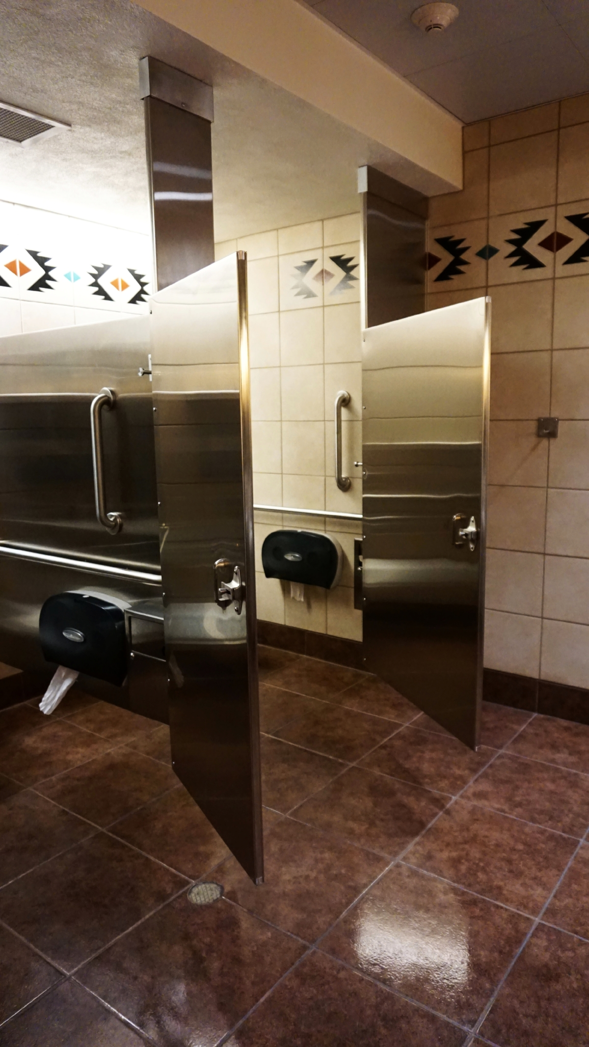 albuquerque int'l sunport bathroom, new mexico - Note that the doors open OUT. The lighting is beautiful and the bathrooms are always spotlessly clean.