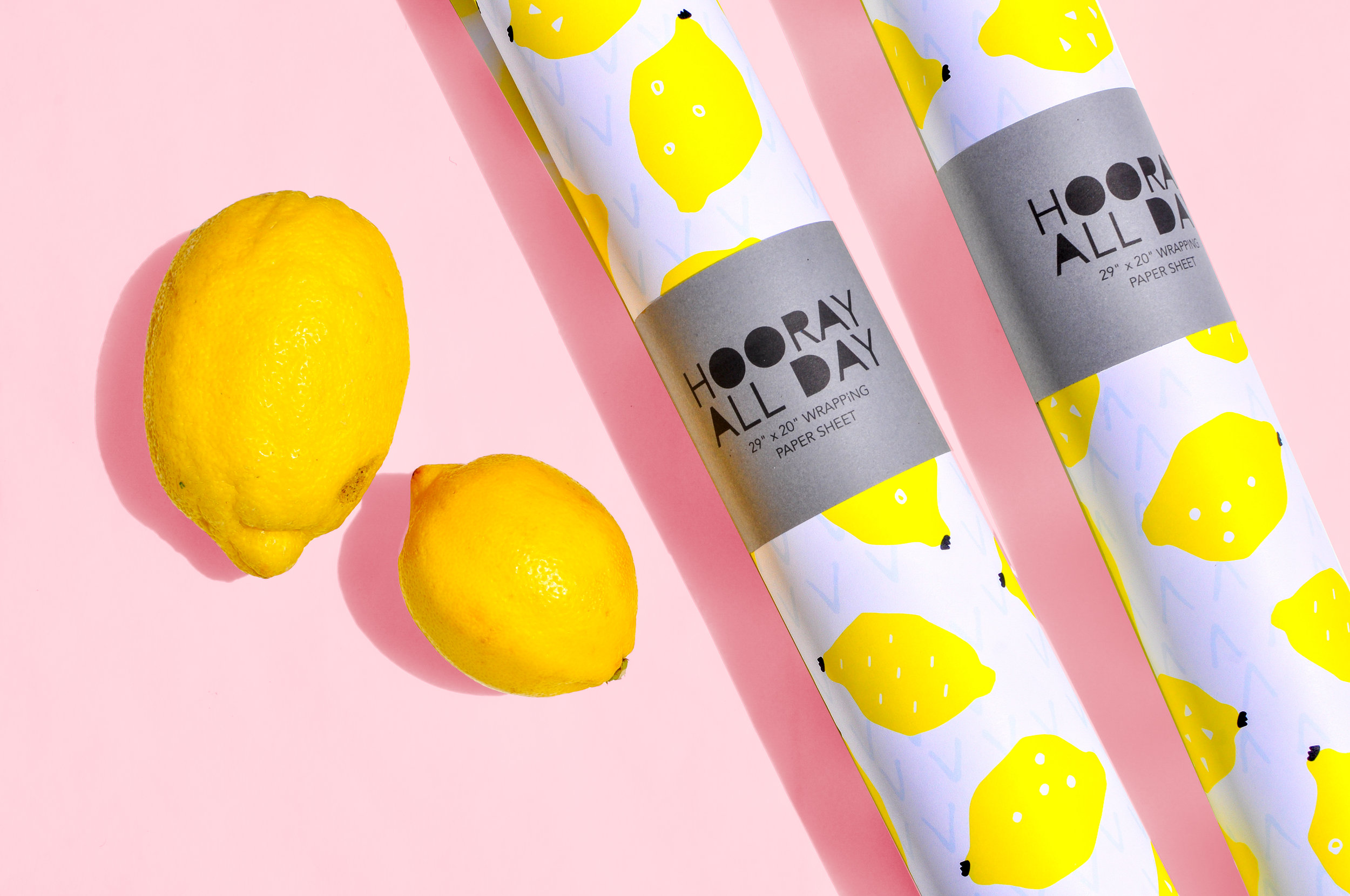Lemon Wrapping Paper Product Shot Two Rolls with Lemons Pink Background.jpg