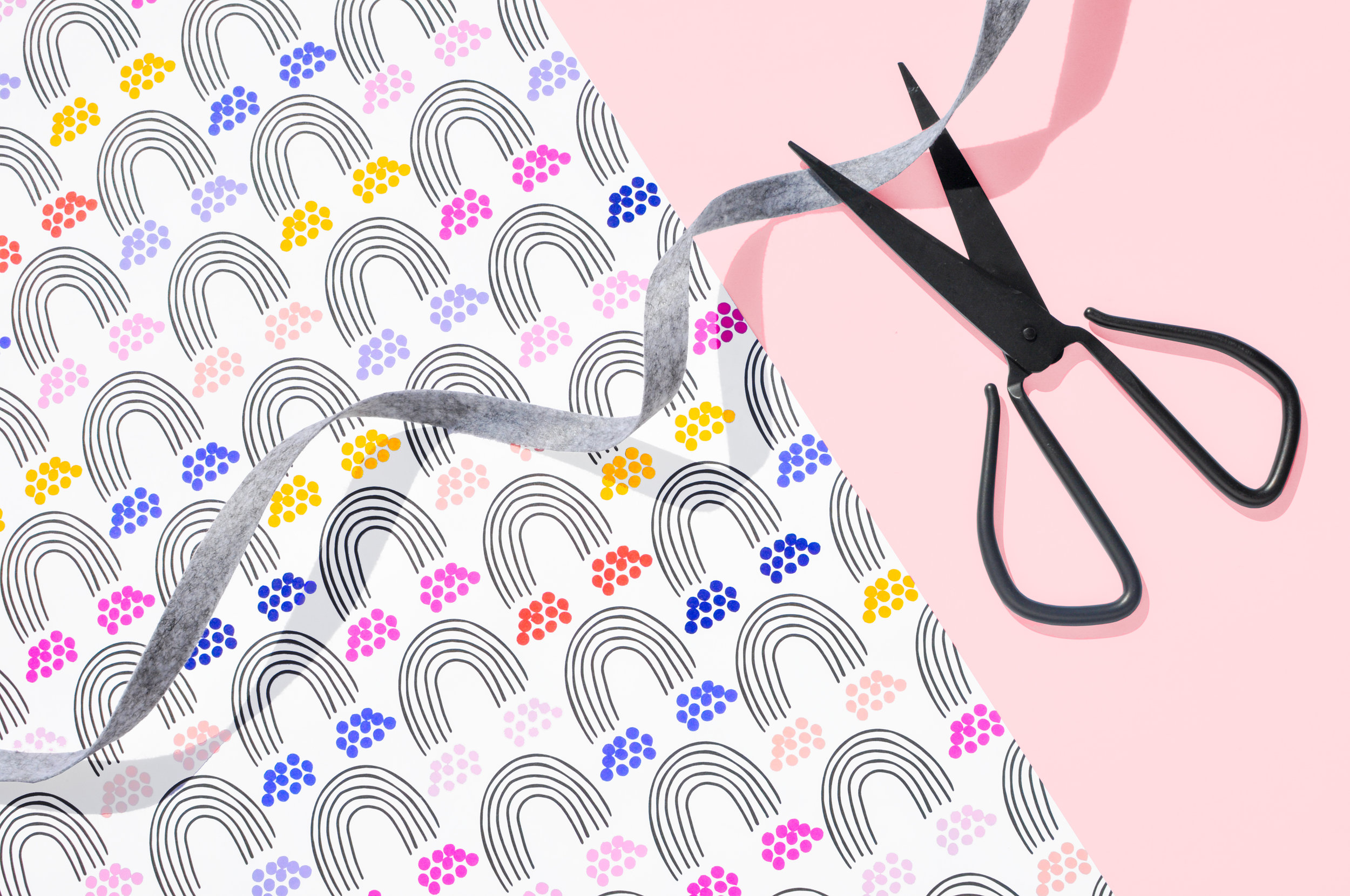 Rainbow Wrapping Paper Product Shot Flat with Scissors.jpg