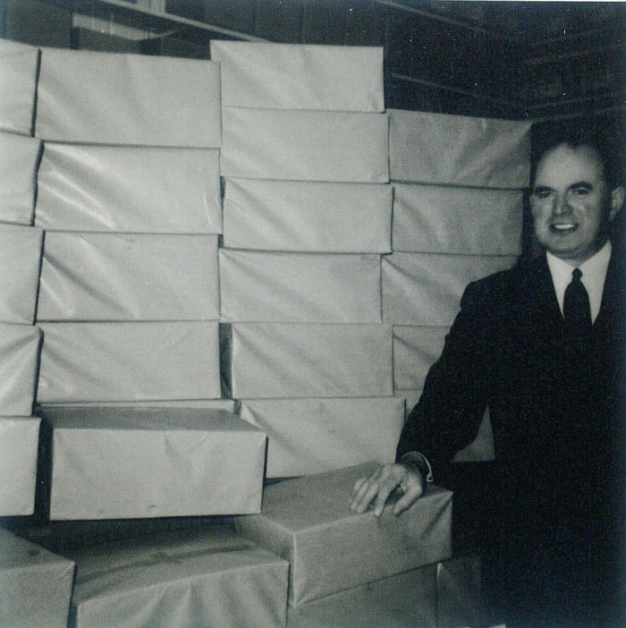 Mr. Allen with literature printed in Outlook Press 1970