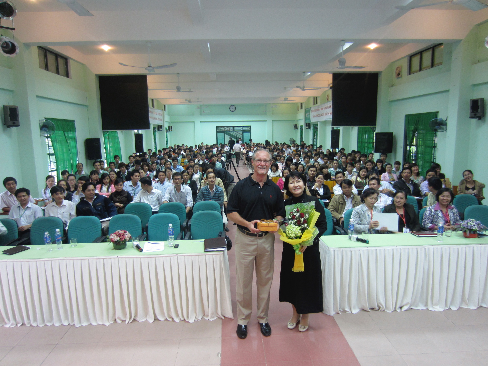 Being given a gift after teaching in Danang in 2014