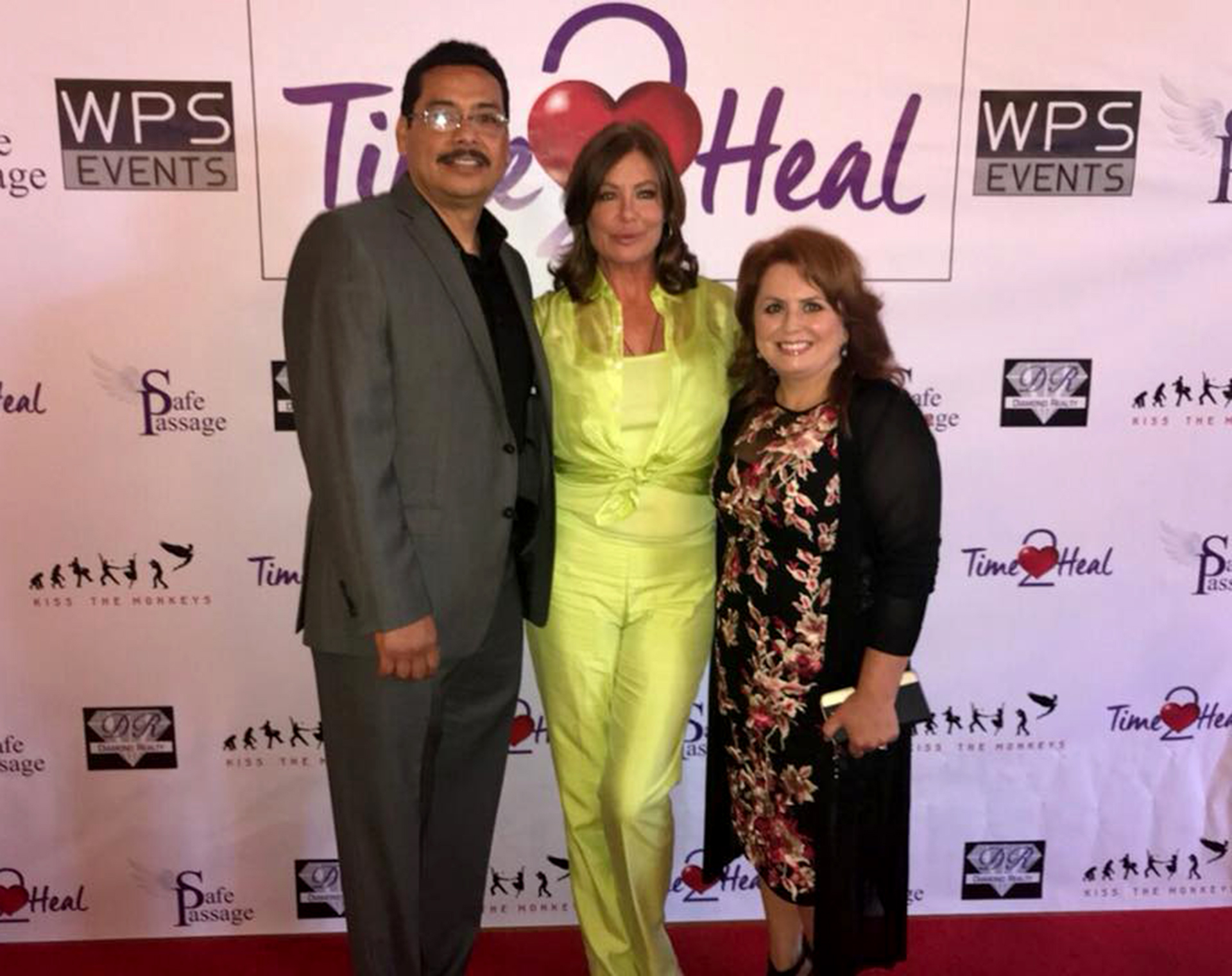 (l-r) Diamond Realty Owner Henry Robledo, Supermodel, Actress & Advocate Kelly LeBrock, and Diamond Realty Owner Theresa Robledo.