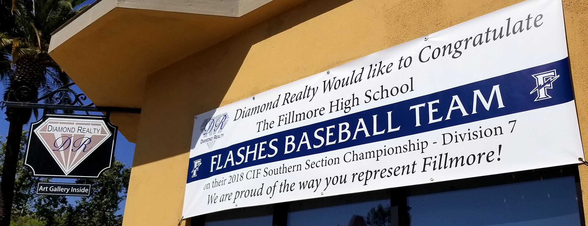 The FHS Boys Baseball CIF Championship banner in front of Diamond Realty's office in Fillmore.