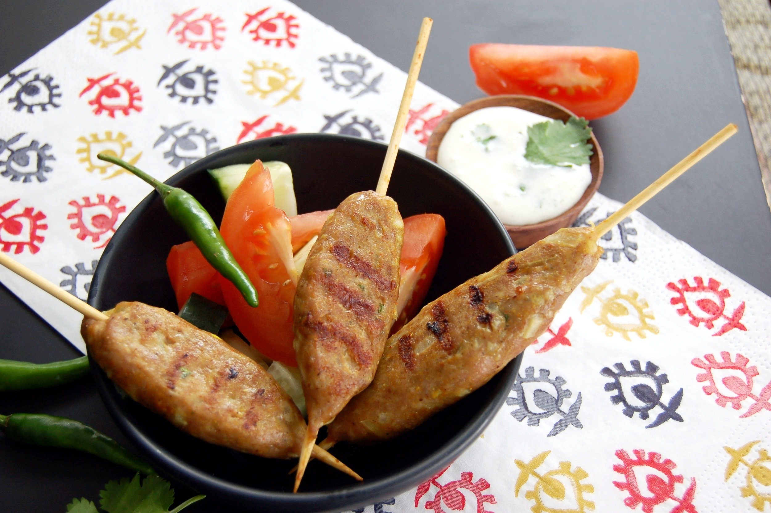 INDIAN-STYLE KEBABS - {Made with Arvinda's Kebab Masala}Savour one of India's most beloved street foods made with Arvinda's Kebab Masala, served with raita and coriander chutney. Stuff into a pita with garlic mayo sauce or make into burgers for your next BBQ, these incredibly delicious and flavourful kebabs are guaranteed to be hit with family and friends!