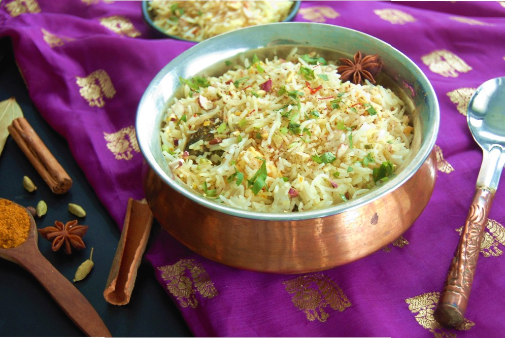 BIRYANI - {Made with Arvinda's Biryani Masala}No other Indian meal conjures the romantic mysticism of this storied land than Biryani. This timeless classic of succulent chicken (or mixed vegetables) simmered in spices and layered with beautifully aromatic, jeweled basmati rice is one of the most magnificent ways to enjoy the best of India's spectacular cuisine. A meal-in-one for all to celebrate!