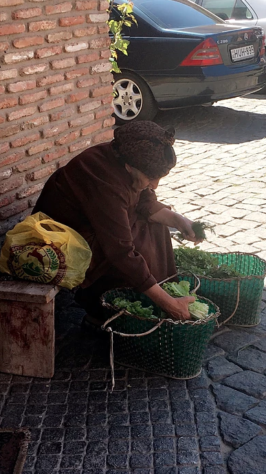 A women sorting out her vegetables in Tbilisi