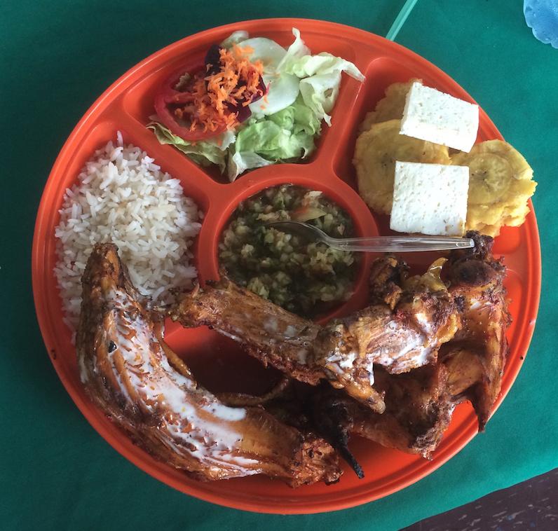A platter of plantains, veggies, rice, cheese, rabbit, iguana and anaconda (longer piece on the left).