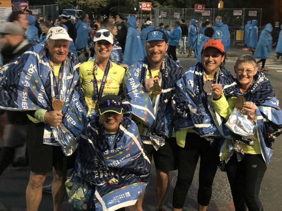 Finish line picture of Keryn Lowry, Peter Loft, Brennan Loft, Marianne and Rebecca.