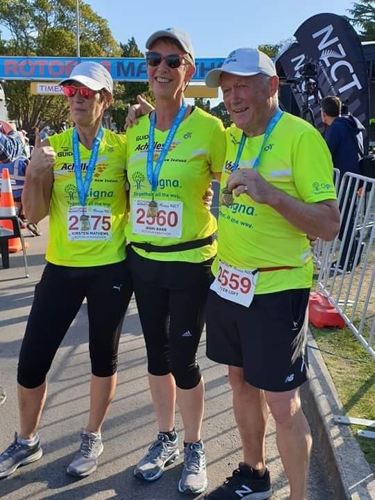 Jenni Barr, Kirsten Matthews and Peter Loft together at the finish line of the Rotorua Marathon