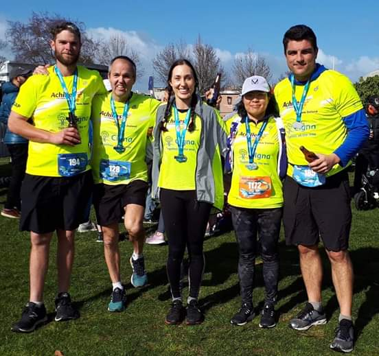 Rotorua athletes and guides with their finishes medals at the Taupo Marathon event