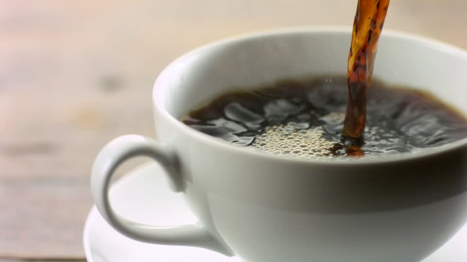 386523652-hot-beverage-coffee-cup-mug-pouring-out.jpg