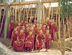Lelung Rinpoche with monks in front of the Kongpo Kangtsen dormitory being built at Drepung Monstery, India, 1992. Lelung Rinpoche, seated in the front row on the right, assisted with the construction