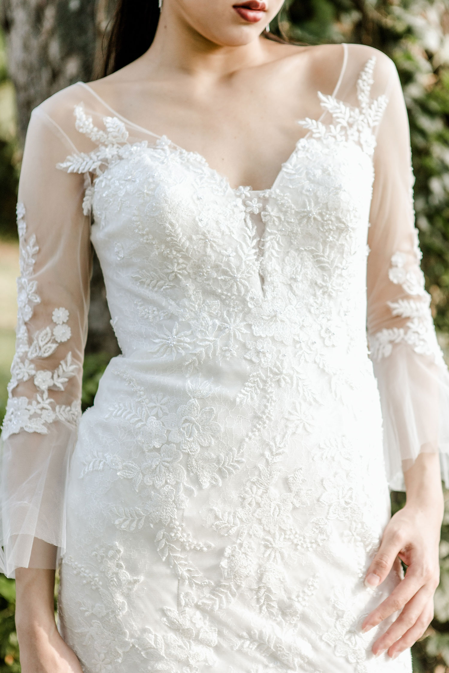Three quarter sleeve wedding dress with a plunging neckline from CCM Wedding