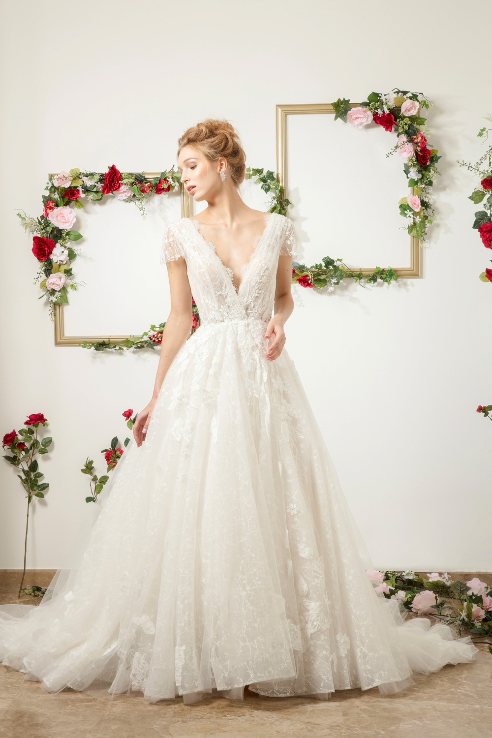 A line wedding dress with plunging neckline by CCM Wedding